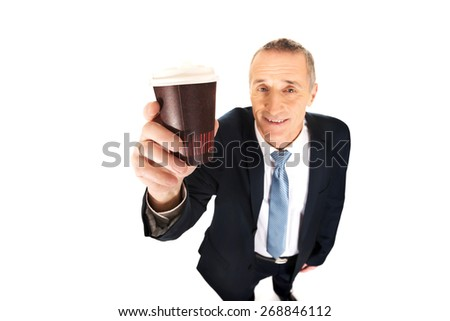 Smiling mature businessman with a cup of coffee. - stock photo