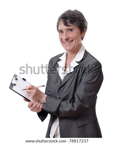 smiling mature businesswoman taking notes with a pad isolated on white background - stock photo