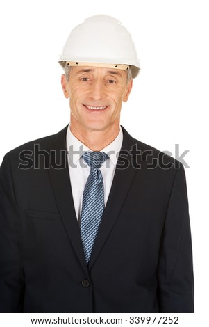 Smiling mature engineer with hard hat. - stock photo