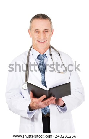 Smiling mature male doctor holding notebook.