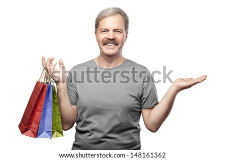 smiling mature man holding shopping bags isolated on white background - stock photo