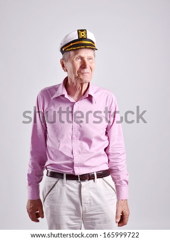 smiling mature man in a sailor cap - stock photo