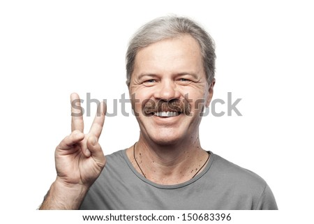 smiling mature man showing victory sign isolated on white background - stock photo