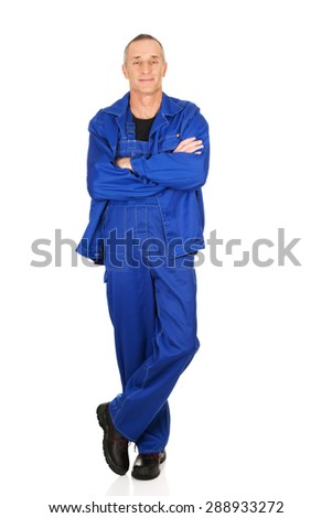 Smiling mature repairman with folded arms. - stock photo