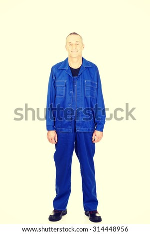 Smiling mature worker in uniform. - stock photo