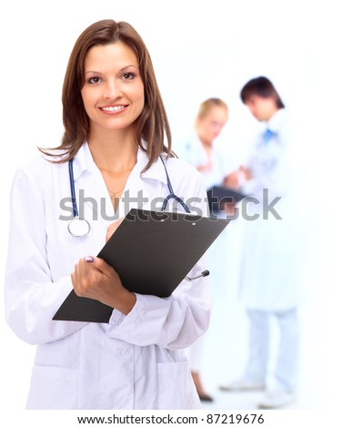 Smiling medical doctor and Over white background - stock photo