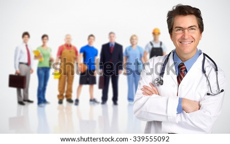 Smiling medical doctor man and group of workers people. - stock photo