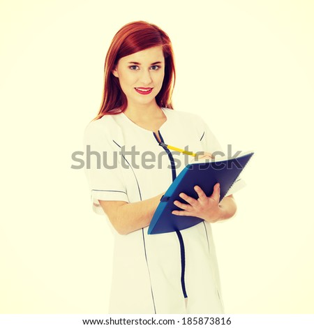 Smiling medical doctor or nurse. - stock photo