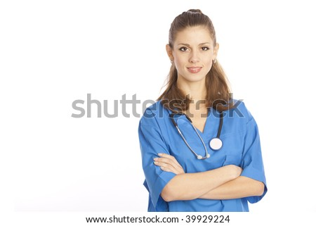 Smiling medical doctor standing with stethoscope - stock photo
