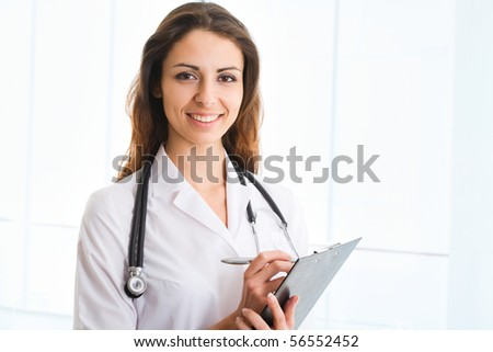 Smiling medical doctor with stethoscope. - stock photo