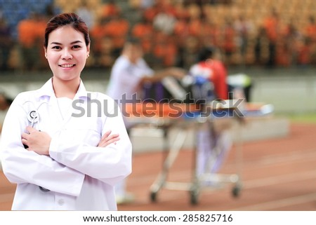 Smiling medical doctor woman Asia with stethoscope on  Stretcher and hospital trolley background  - stock photo