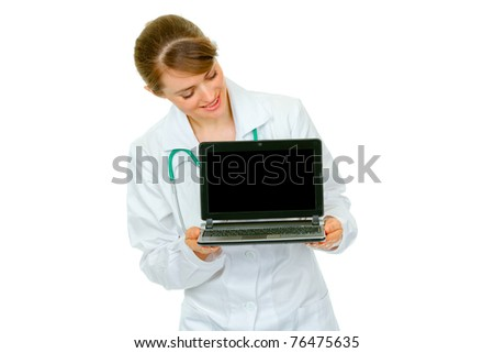 Smiling  medical doctor woman looking on laptop with blank screen isolated on white - stock photo