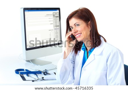 Smiling medical doctor woman with computer and telephone. Isolated over white background - stock photo