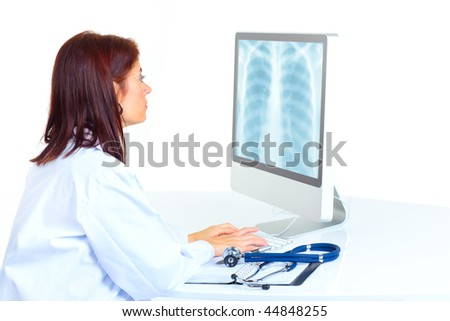 Smiling medical doctor woman with computer. Isolated over white background - stock photo