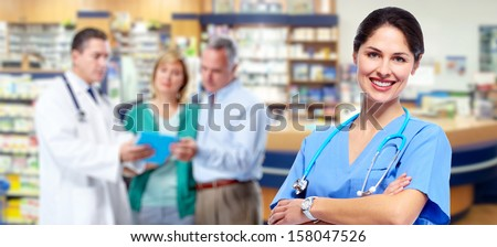 Smiling medical doctor woman with stethoscope. Pharmacy. - stock photo