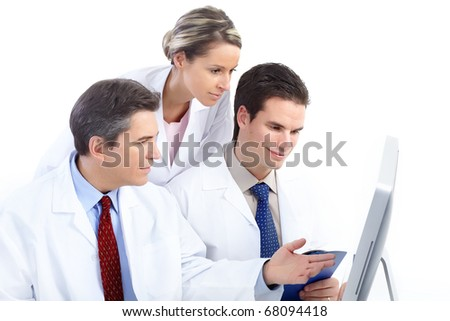Smiling medical doctors working with a computer. Isolated over white background