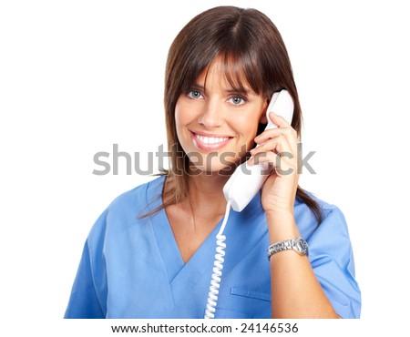 Smiling medical nurse with telephone. Isolated over white background - stock photo