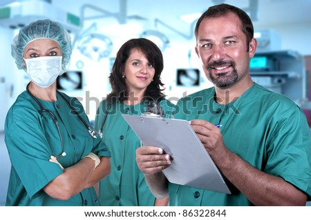 Smiling medical team in a hospital interior - stock photo
