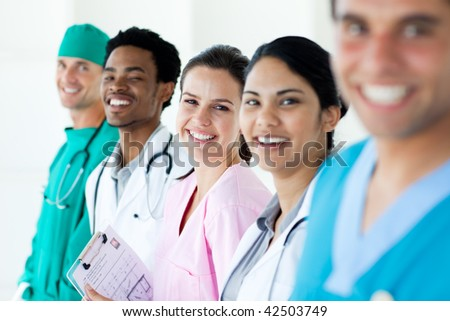 Smiling medical team in a line isolated on a white background - stock photo