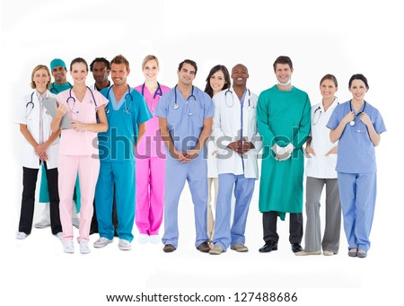 Smiling medical team of doctors nurses and surgeons on white background - stock photo