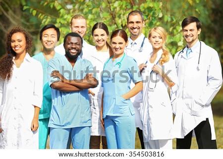 Smiling medics team, outdoors - stock photo