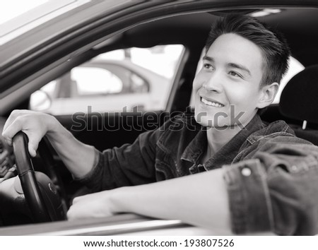Smiling men sitting in the car. - stock photo