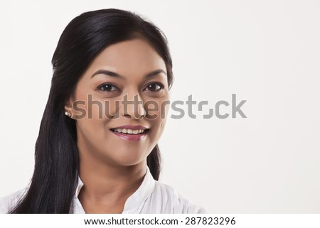 Smiling mid adult woman over white background