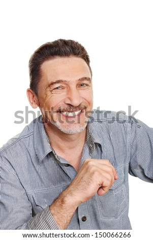 Smiling middle age man with grey shirt - stock photo