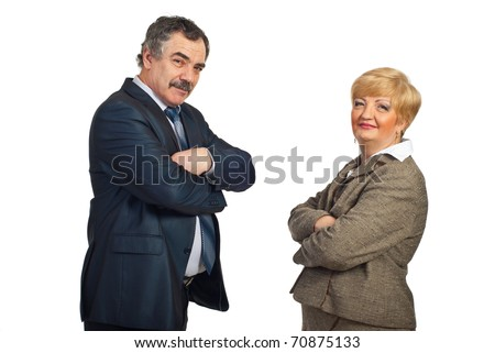 Smiling middle aged business people team standing face to face with arms folded isolated on white background - stock photo