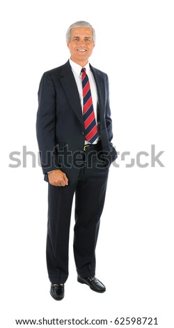 Smiling middle aged businessman in a suit and tie standing with one hand in his pocket and the other buy his side. Full length over a white background. - stock photo