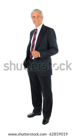 Smiling middle aged businessman in a suit and tie standing with one hand in his pocket. Business man is in full  length over a white background. - stock photo