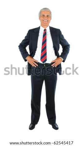 Smiling middle aged businessman in a suit and tie with his hands on hips. Business man is in full   length over a white background. - stock photo