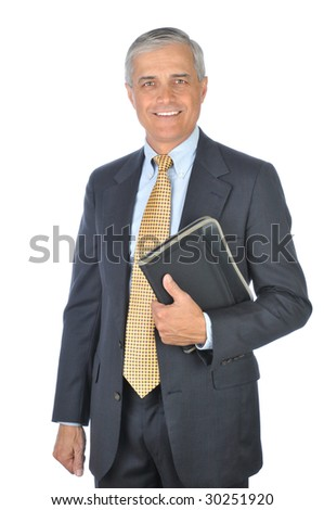 Smiling Middle Aged Businessman in dark suit standing with notebook isolated on white