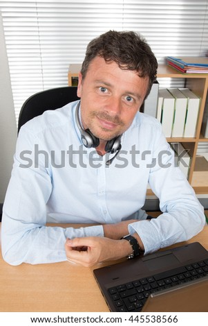 Smiling middle aged call center executive