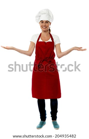 Smiling middle aged female chef with open arms - stock photo