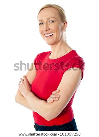 Smiling middle aged lady, posing with folded arms isolated over white background