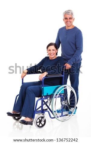 Smiling carer pushing an old man in a wheelchair stock photo image - Woman Disabled Man Pushing Stock Photos Images