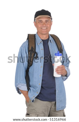Smiling middle aged man wearing a day pack preparing for a hike. Man is holding a water bottle the other hand is in his pocket. 3/4 view of man in Vertical Format isolated over white . - stock photo