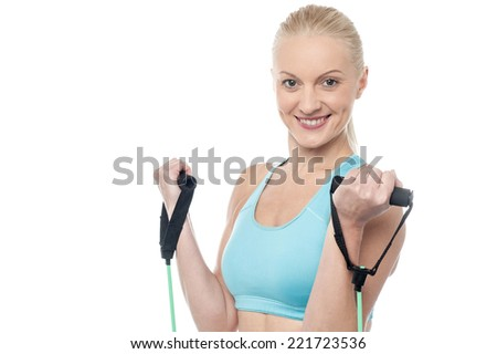 Smiling middle aged woman exercising with a resistance band - stock photo
