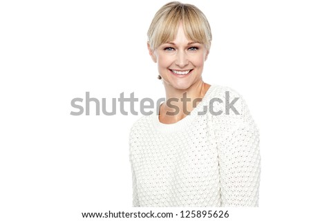 Smiling middle aged woman in trendy wear isolated over white background. - stock photo