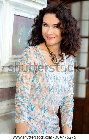 smiling middle-aged woman portrait - stock photo