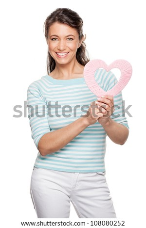 Smiling middle aged woman wird heart - stock photo