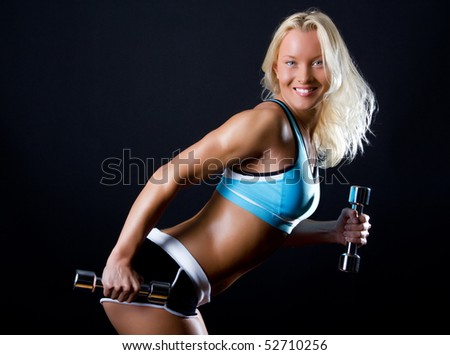 Smiling model during her training for triceps