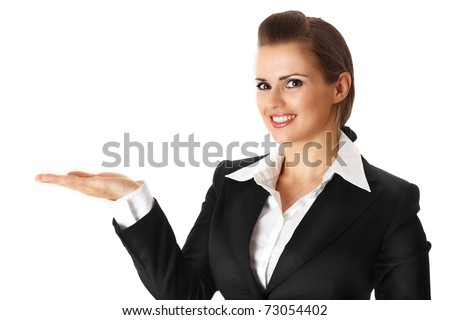 smiling modern business woman presenting something on empty hand isolated on white - stock photo