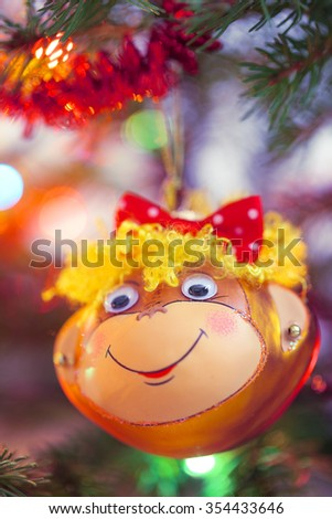 Smiling monkey christmas decoration. Symbol of new year 2016