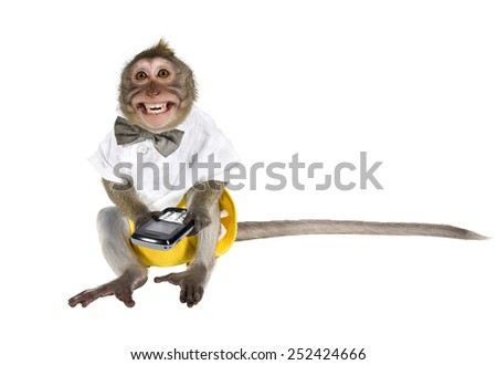 Smiling monkey in a suit and with a cell phone. Isolated on white background - stock photo