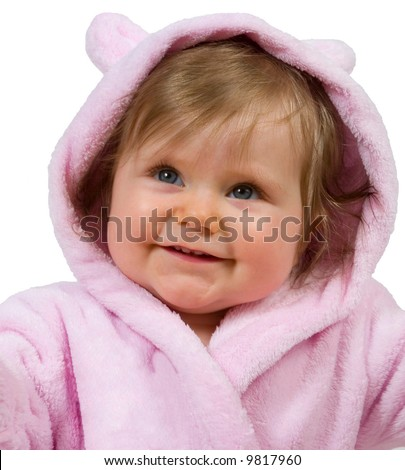 Smiling 9 month old baby girl in pink bathrobe - stock photo