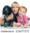 Smiling mother and little girl with dog on a white background - stock photo