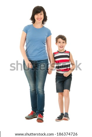 Smiling mother and son full body walking isolated on white