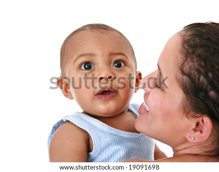 Smiling Mother Holding Baby on Isolated Background - stock photo
